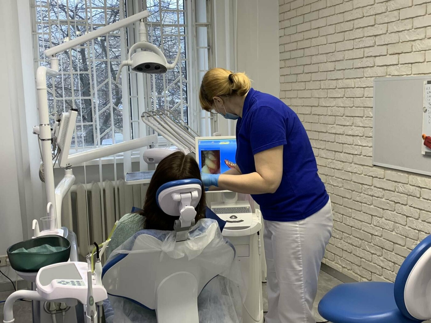 Лучшие стоматологические клиники Киева, безболезненное лечение зубов в столице, фото-63
